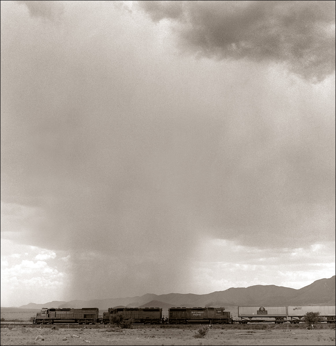 © James-H-Evans-Train and Isolated Rain